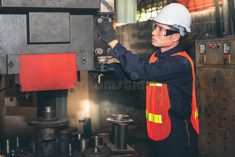 Technicians Asian man are checking and maintenance of industrial machinery. Engineers or technicians Asian man are checking and maintenance of industrial stock images