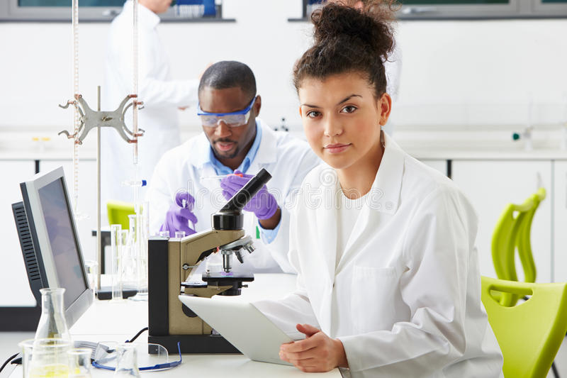 Technicians Carrying Out Research In Laboratory royalty free stock photo