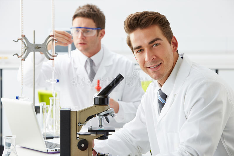 Technicians Carrying Out Research In Laboratory stock image