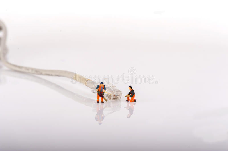 Technicians with cat5 network cable. Networking concept. Macro photo. Over white background royalty free stock photography
