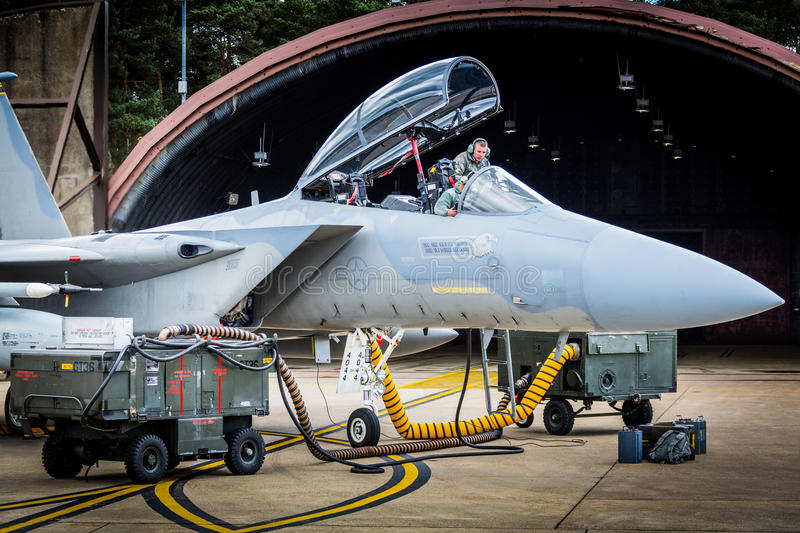 Technicians checking his F15 fighter jet. Technicians check his USAF F15 fighter jet whilst in its hangar, RAF Lakenheath 29th April 2016 royalty free stock photo