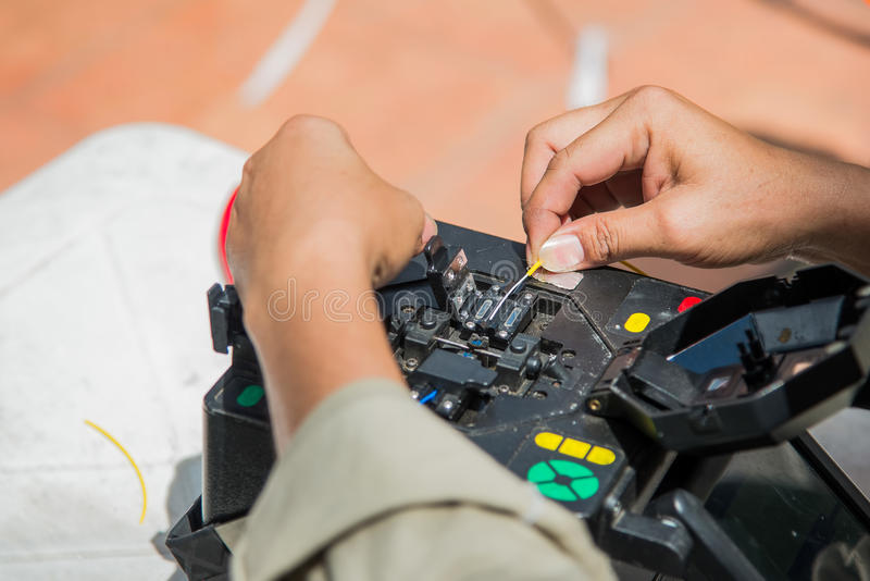 Technicians cutting and fusion fiber optic cables. royalty free stock photography