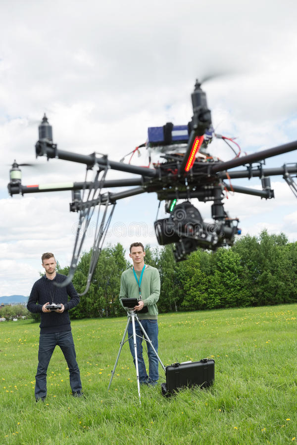 Technicians Flying UAV Spy Drone royalty free stock images
