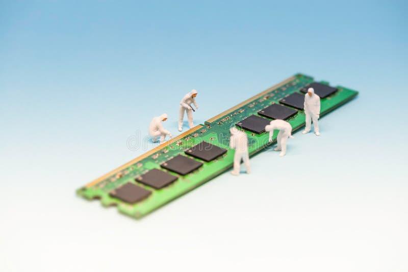 Technicians inspecting RAM memory module. Macro photo.  royalty free stock photos