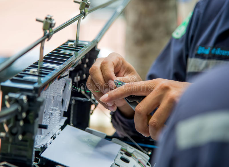 Technicians install cabinet on fiber optic cable. Technicians are install cabinet on fiber optic cable royalty free stock photo
