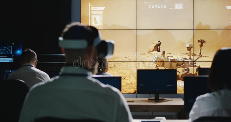 Technicians overlooking Mars rover movement royalty free stock photo