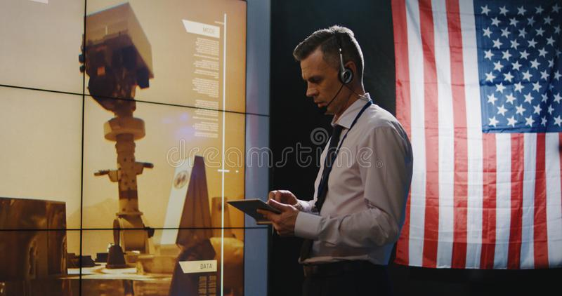Technicians overviewing Mars landing royalty free stock photo