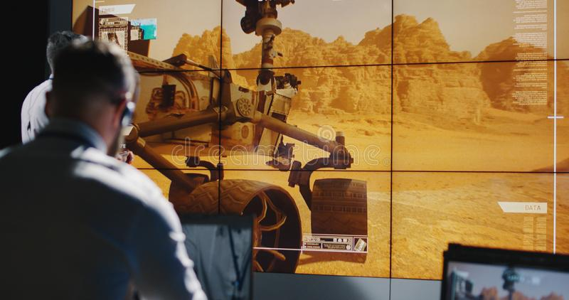 Technicians overviewing Mars landing royalty free stock photos