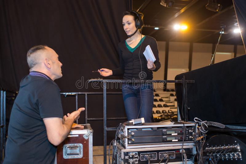Technicians preparing stage before performance. Technicians preparing the stage before performance stock photography