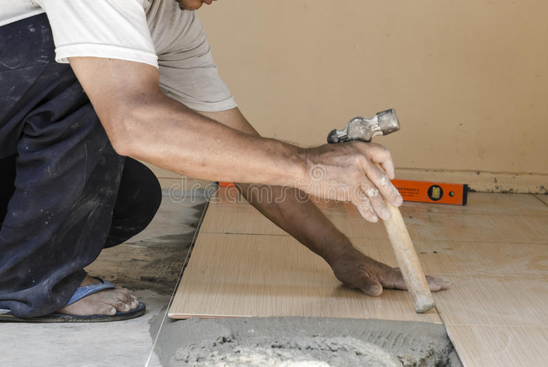 Technicians renovation are tiled. Technicians renovation Are working on tiles stock photos
