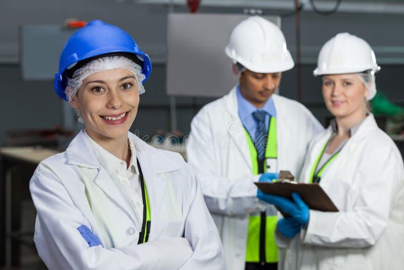 Technicians standing in meat factory. Portrait of technicians standing in meat factory stock images