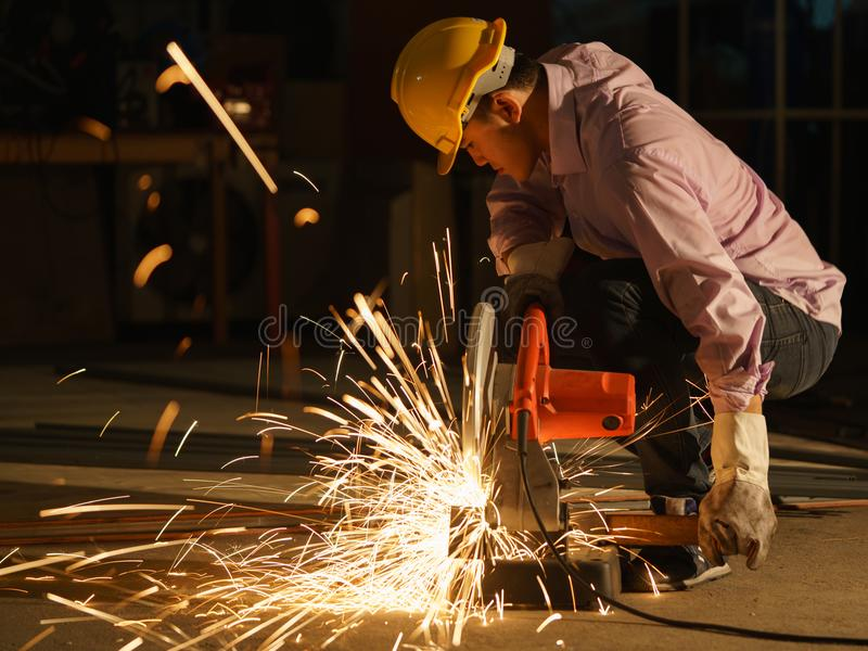 Technicians use steel cutting tools to build houses. royalty free stock images