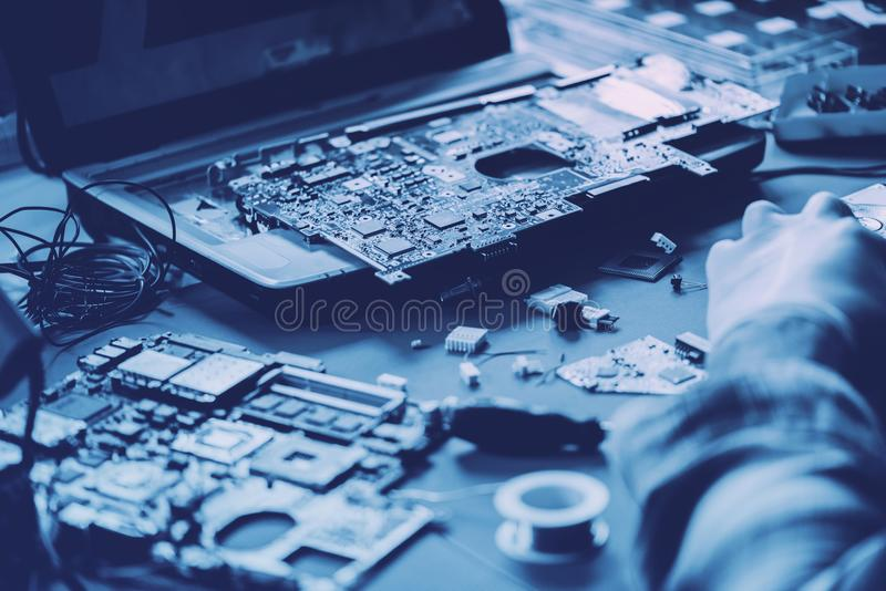 Technicians working on computer mainboard royalty free stock photos