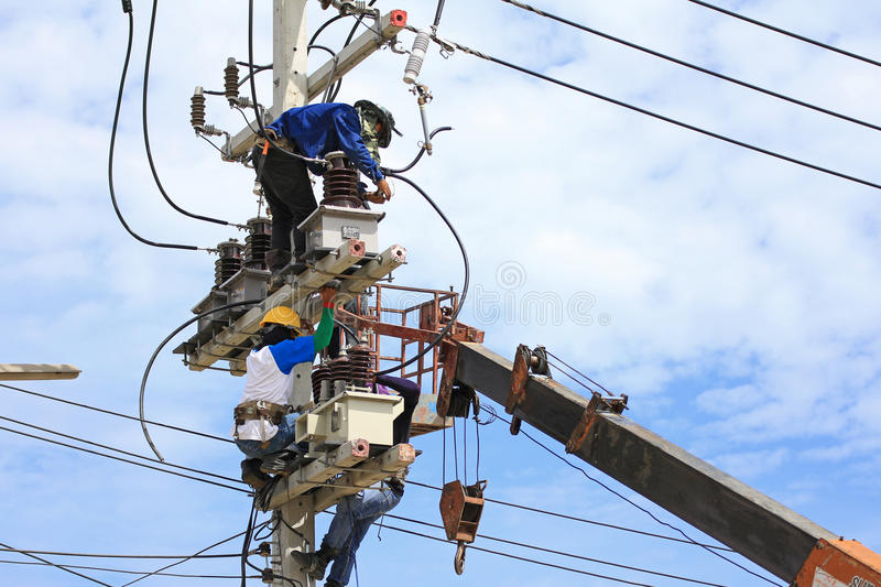 Technicians Working on Electrical Pole stock photos