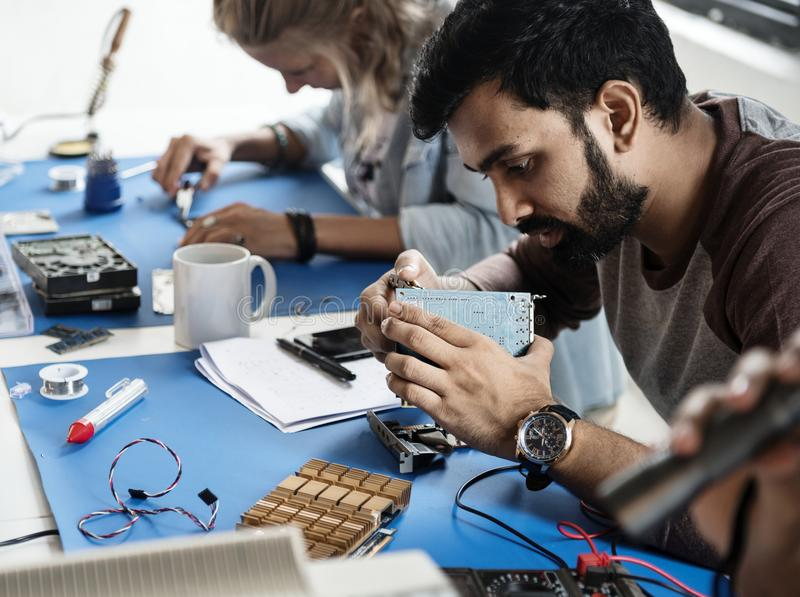 Technicians working on electronics parts stock photography