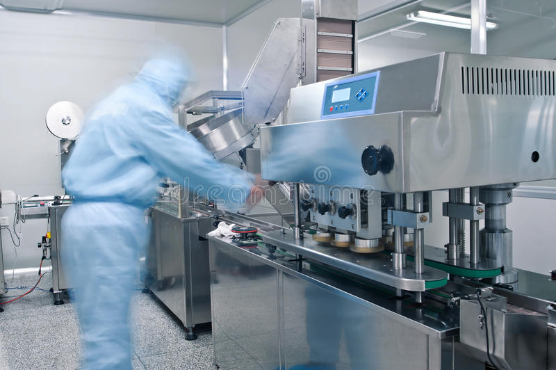 Technicians working in the pharmaceutical production