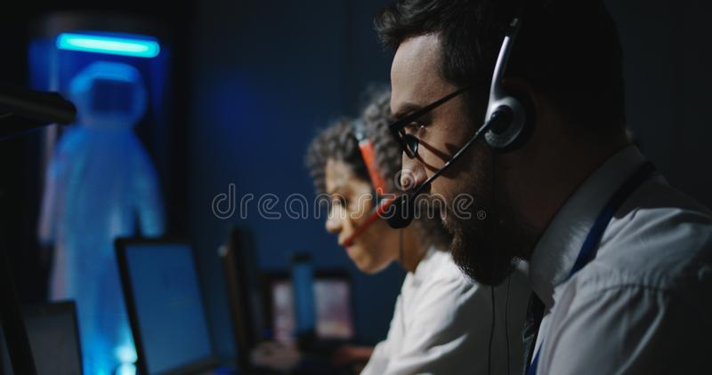 Technicians working at their desks stock photos