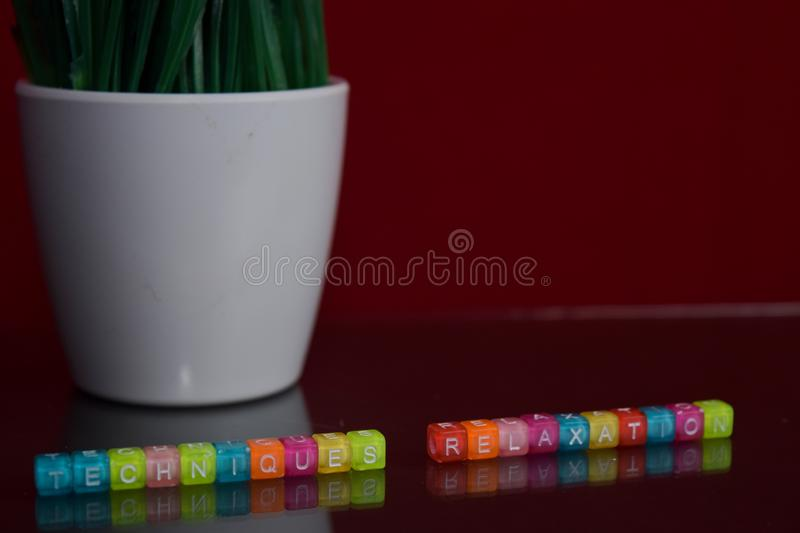 Techniques relaxation text at colorful wooden block on red background. Desk office and education concept royalty free stock photos