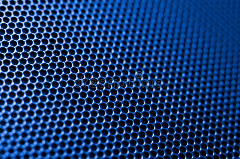 Techno background. Of metal cellular surface. Low DOF, special toned photo f/x royalty free stock photo