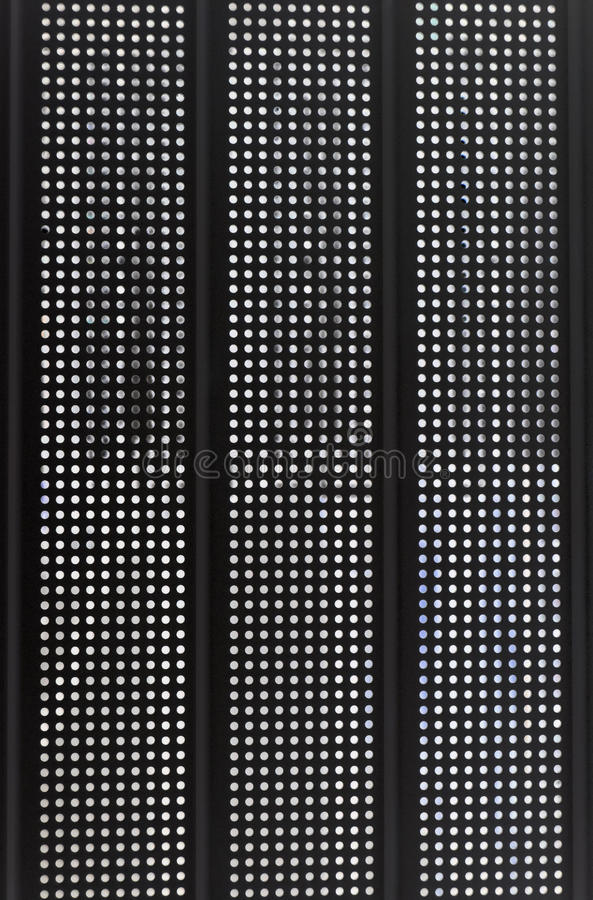 Techno background - black panel. With vertical rows of apertures stock photography