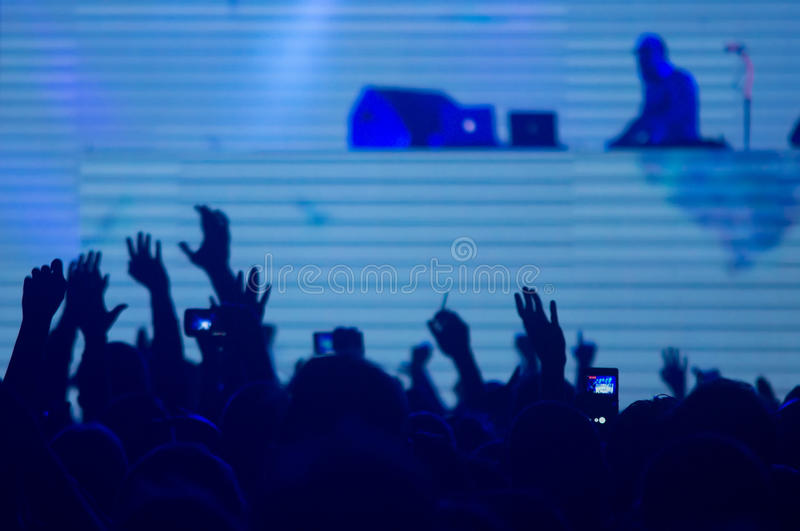 At the techno concert. People enjoying at the techno concert royalty free stock photography
