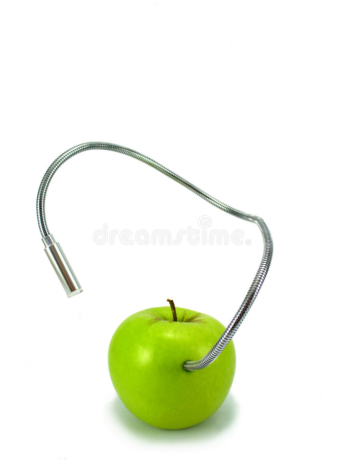 Techno green. Green apple with techno worm stock photography