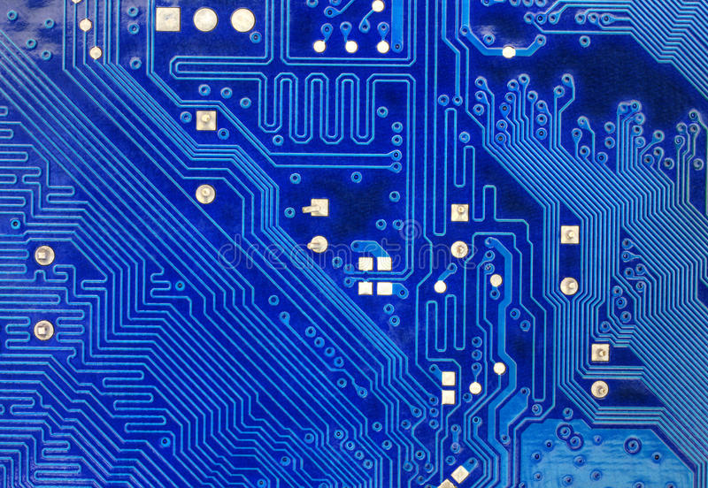 Technological background with computer motherboard. Technological background with blue computer motherboard closeup stock images