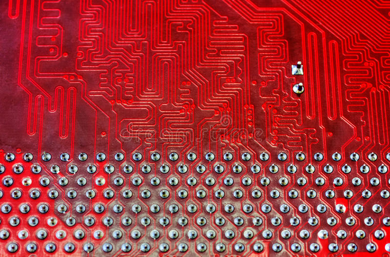 Technological background with computer motherboard. Technological background with red computer motherboard closeup royalty free stock photos