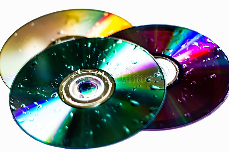 Technological background created with the photo of cd, the light accentuates the reflections coloring them.  stock photography
