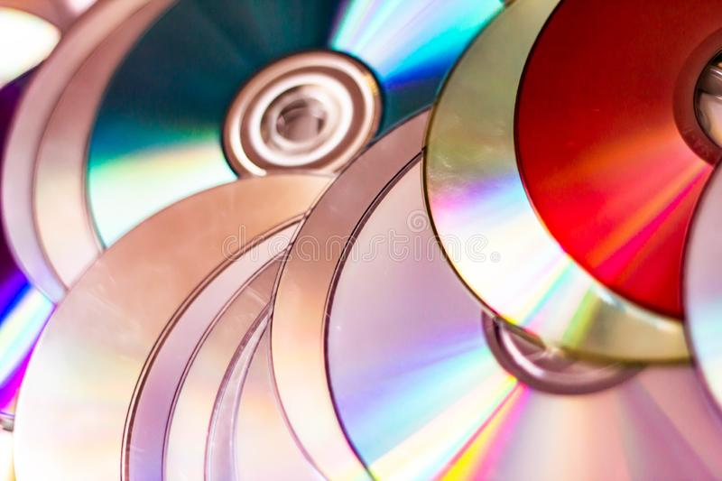 Technological background created with the photo of cd, the light accentuates the reflections coloring them.  royalty free stock image