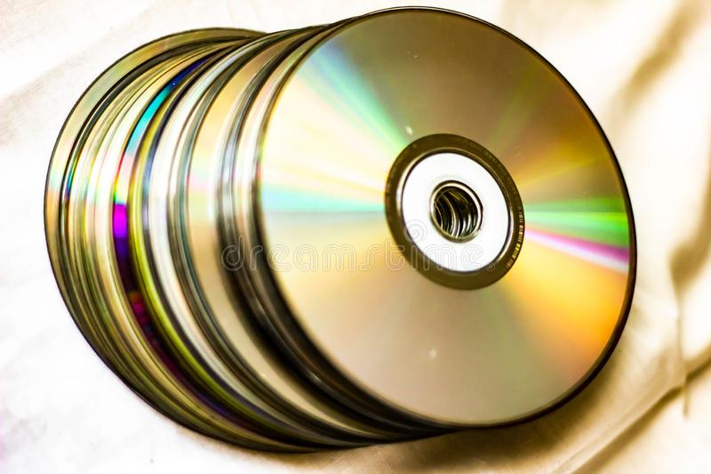 Technological background created with the photo of cd, the light accentuates the reflections coloring them.  royalty free stock photos