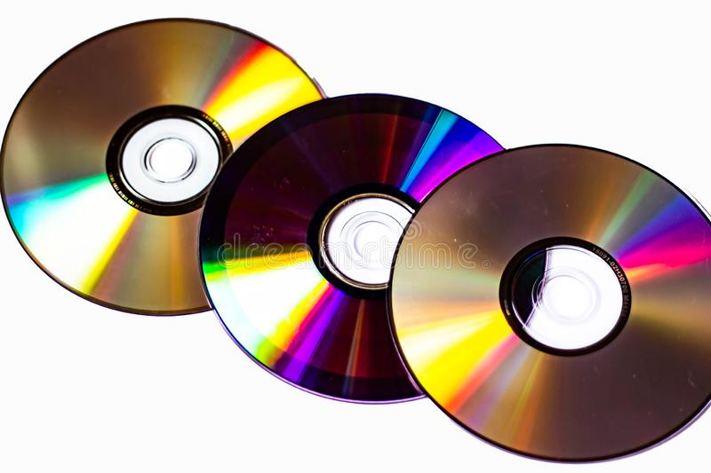Technological background created with the photo of cd, the light accentuates the reflections coloring them.  stock image