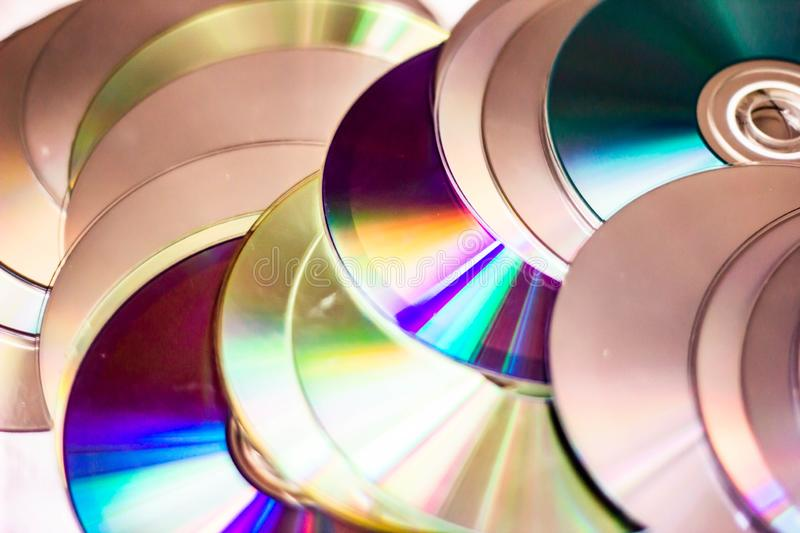 Technological background created with the photo of cd, the light accentuates the reflections coloring them.  royalty free stock photo