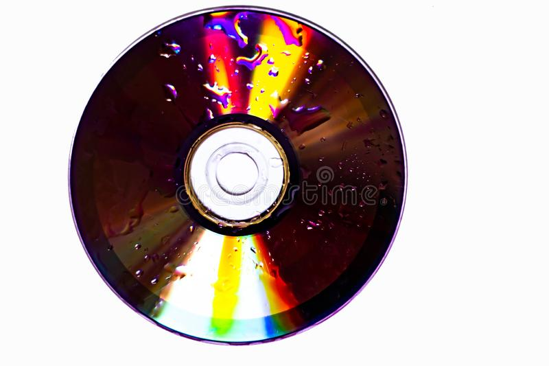 Technological background created with the photo of cd, the light accentuates the reflections coloring them.  stock images