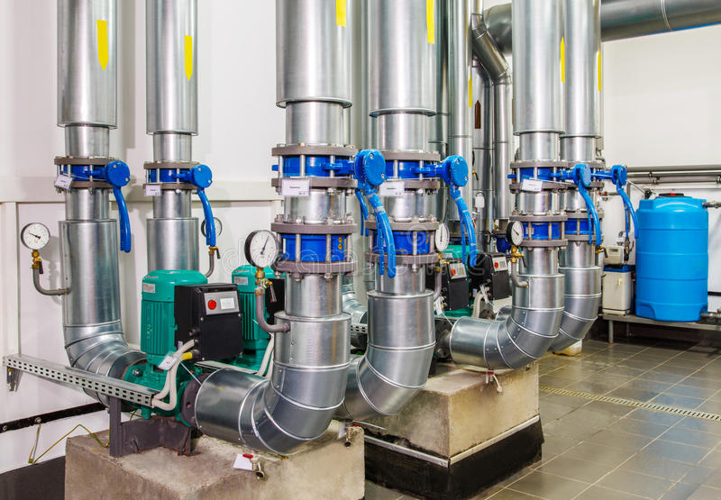 Technological industrial boiler unit with piping and pumps.  royalty free stock photo