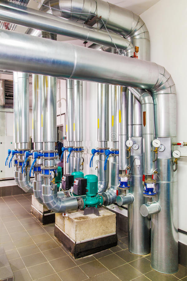 Technological industrial boiler unit with piping and pumps.  stock photo