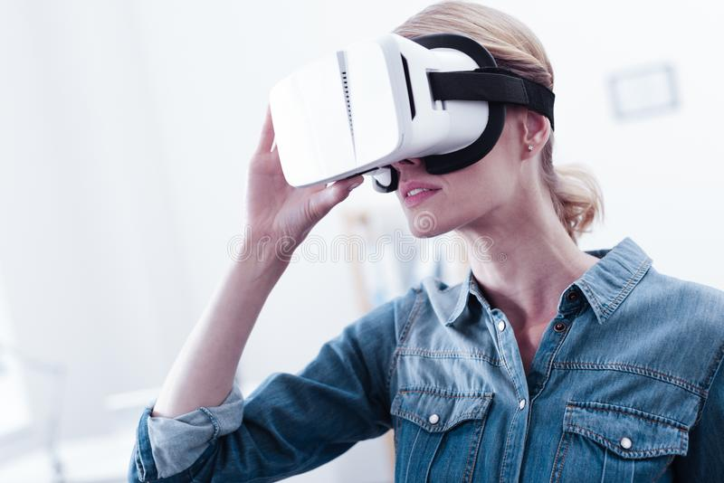 Serious smart woman holding her 3d glasses royalty free stock photos