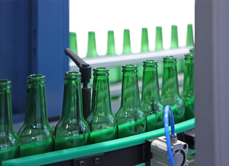 Technological line. For washing of glass bottles for beer royalty free stock image