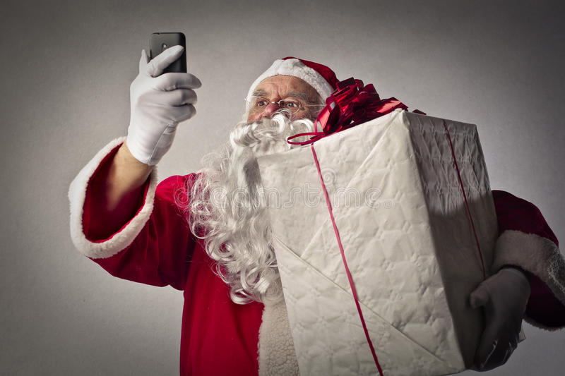 Technological Santa Claus. Doing a selfie stock photography