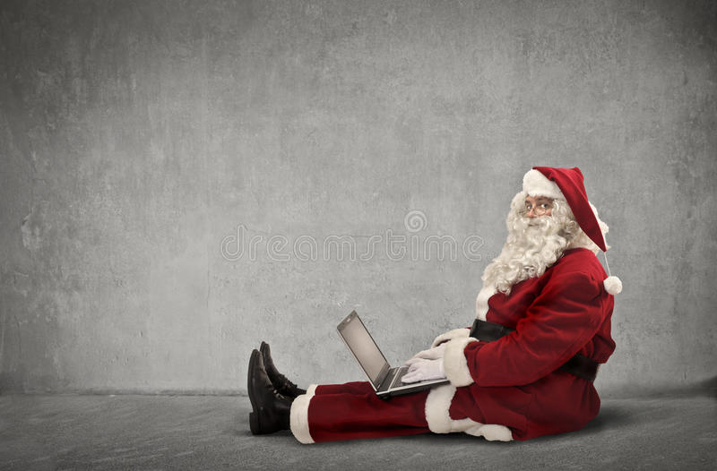 A technological Santa Claus. Using a pc stock images