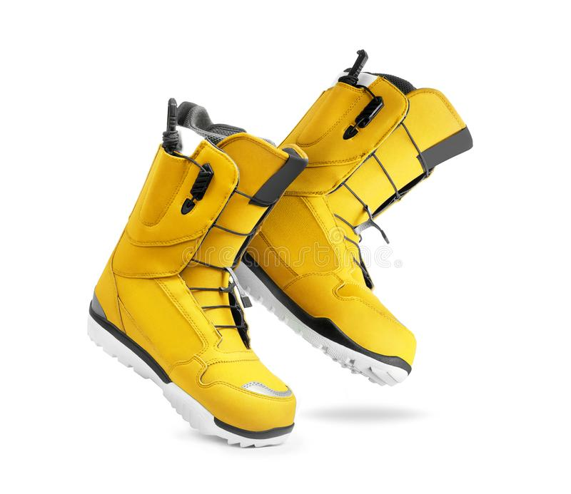 Technological yellow snowboard boots on white background.  royalty free stock image
