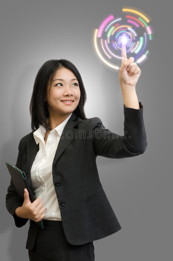 Technologie de contact de femme d'affaires photo stock