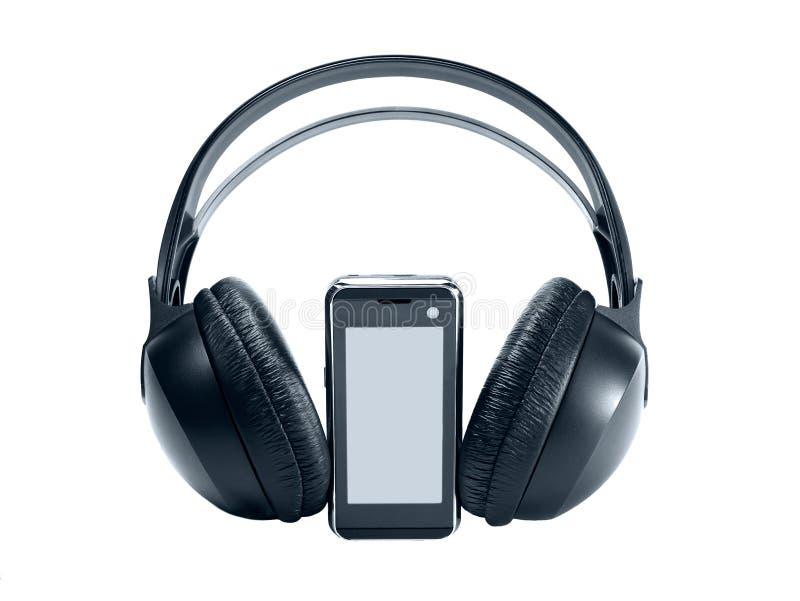 Technologie-Handy mit Kopfhörern lizenzfreies stockbild