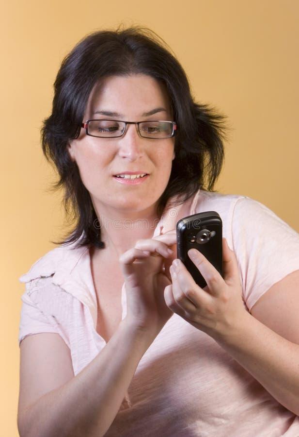 technologii komunikacyjnej kobiety potomstwa zdjęcie stock