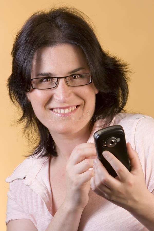 technologii komunikacyjnej kobiety potomstwa zdjęcia stock