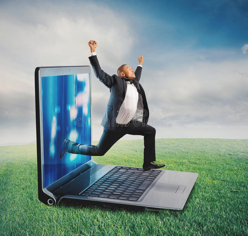 Technology addiction concept. Businessman leaves the screen of a computer to a lawn. Technology addiction concept stock images