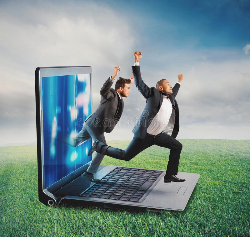 Technology addiction concept. Businessmen leaves the screen of a computer to a lawn. Technology addiction concept royalty free stock photo