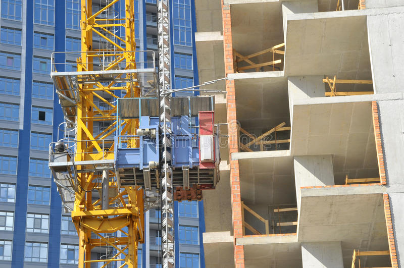 The technology or art of high rise apartment construction using crane, lift, metal beam, brick, metal ladder. And concrete stock photos