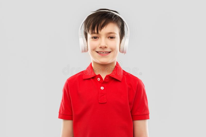 Smiling boy in headphones listening to music royalty free stock images