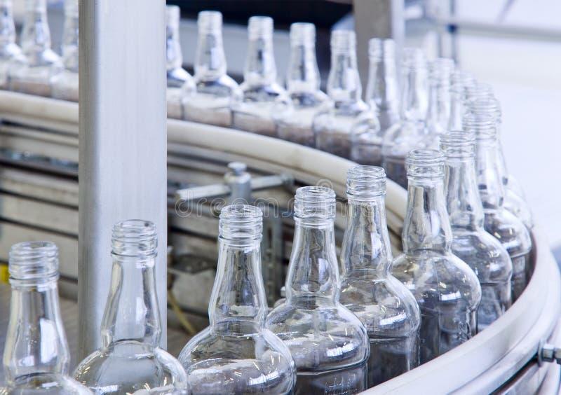 Technology bottling plant for bottles. New bottling plant for glass bottles royalty free stock photography